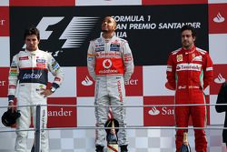 Podium: race winner Lewis Hamilton, McLaren Mercedes, second place place Sergio Perez, Sauber F1 Tea