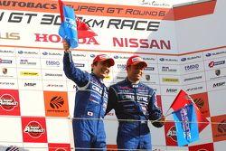 Race winnaars Joao Paulo de Oliveira en Tsugio Matsuda