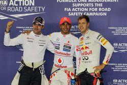 Ganador de la pole position Lewis Hamilton, McLaren, segundo Pastor Maldonado, Williams, tercero Seb