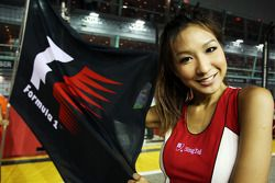 Grid girl with F1 flag