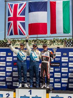 Race 1 Podium: winner Yvan Muller, second place Robert Huff, third place Norbert Michelisz