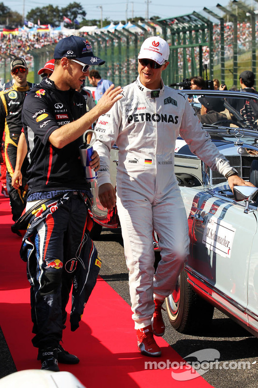 Sebastian Vettel, Red Bull Racing with Michael Schumacher, Mercedes AMG F1 on the drivers parade