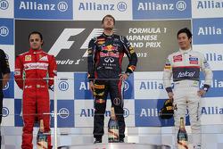 First place for Sebastian Vettel, Red Bull Racing second place for Felipe Massa, Scuderia Ferrari and third place for Kamui Kobayashi, Sauber F1 Team