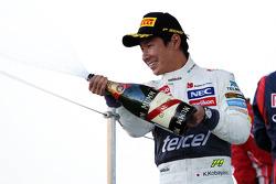 Kamui Kobayashi, Sauber celebrates his third position on the podium