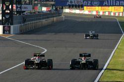 Romain Grosjean, Lotus F1 Team et Heikki Kovalainen, Caterham F1 Team