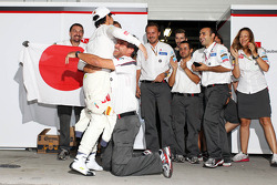 Kamui Kobayashi, Sauber celebrates his third position with Beat Zehnder, Sauber F1 Team Manager and