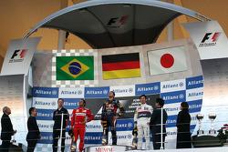 First place for Sebastian Vettel, Red Bull Racing second place for Felipe Massa, Scuderia Ferrari an