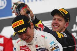 Kamui Kobayashi, Sauber celebrates his third position on the podium with race winner Sebastian Vettel, Red Bull Racing