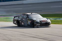 Jeff Burton limps back to the pits