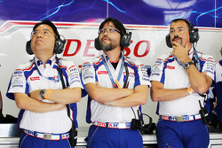 Toyota racing crew members look on