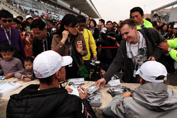 Michael Schumacher, Mercedes AMG F1 and Nico Rosberg, Mercedes AMG F1 sign autographs for the fans