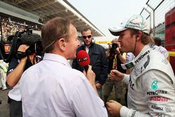 Martin Brundle, Sky Sports Commentator with Nico Rosberg, Mercedes AMG F1 on the grid