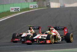 Paul di Resta, Sahara Force India Formula One Team and Narain Karthikeyan, HRT Formula One Team