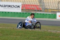 Alex Zanardi with his hand bike on track