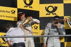Podium: Charly Lamm, team manager BMW Team Schnitzer gets sprayed with champagned by Bruno Spengler,