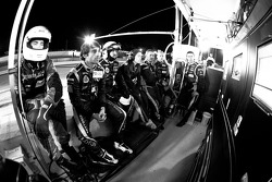 Nicolas Prost and Rebellion Racing team members watch the end of the race