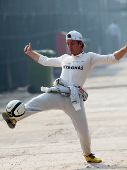 Nico Rosberg, Mercedes AMG F1 warms up with some football in the paddock