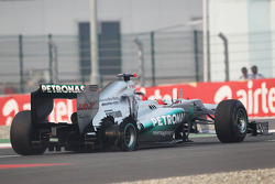 Michael Schumacher, Mercedes AMG F1 limps to the pits with a puncture