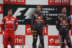 1st place Sebastian Vettel, Red Bull Racing with 2nd place Fernando Alonso, Scuderia Ferrari and 3rd place Mark Webber, Red Bull Racing