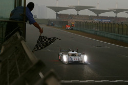 #1 Audi Sport Team Joest R18 e-tron quattro: Marcel Fässler, Benoit Tréluyer, Andre Lotterer takes the checkered flag