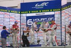 Overall podium: winners Alexander Wurz, Nicolas Lapierre, second place Tom Kristensen, Allan McNish, third place Andre Lotterer, Benoit Tréluyer, Marcel Fässler