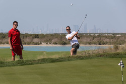 James Courtney and Dean Fiore take time out for a bit of golf at the Yas country club