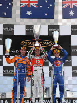 Podium: race winner Jamie Whincup, second place Will Davison, third place Tim Slade