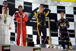 The podium: second place Fernando Alonso, Ferrari, race winner Kimi Raikkonen, Lotus F1 Team, third place Sebastian Vettel, Red Bull Racing