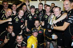 Race winner Kimi Raikkonen, Lotus F1 Team celebrates with the team