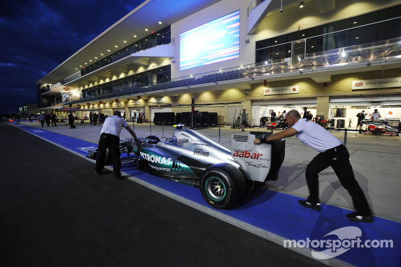 Mercedes AMG F1 team push the car to scrutineering