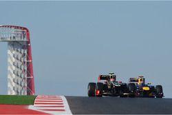 Romain Grosjean, Lotus F1 en Sebastian Vettel, Red Bull Racing