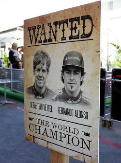 Wild West style sign for championship contenders Sebastian Vettel, Red Bull Racing and Fernando Alonso, Ferrari