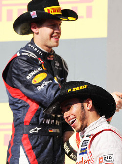 Race winner Lewis Hamilton, McLaren celebrates on the podium with Sebastian Vettel, Red Bull Racing