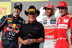 The podium: Sebastian Vettel, Red Bull Racing, second; Mario Andretti, Lewis Hamilton, McLaren, race