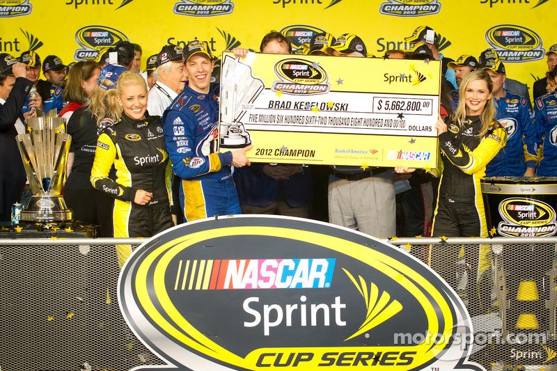 Championship victory lane: 2012 NASCAR Sprint Cup Series champion Brad Keselowski, Penske Racing Dodge accepts the championship check