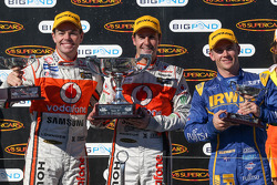 Podium: race winner Jamie Whincup, Team Vodafone, second place Craig Lowndes, Team Vodafone, third place Lee Holdsworth, Irwin Racing