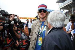 Owen Wilson, with Bernie Ecclestone, CEO Formula One Group, on the grid