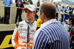 Nico Hulkenberg, Sahara Force India F1 with Kai Ebel, RTL TV Presenter on the grid