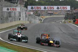 Michael Schumacher, Mercedes GP and Mark Webber, Red Bull Racing