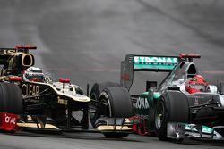 Kamui Kobayashi, Sauber F1 Team and Michael Schumacher, Mercedes GP