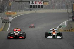 Lewis Hamilton, McLaren Mercedes and Nico Hulkenberg, Sahara Force India Formula One Team