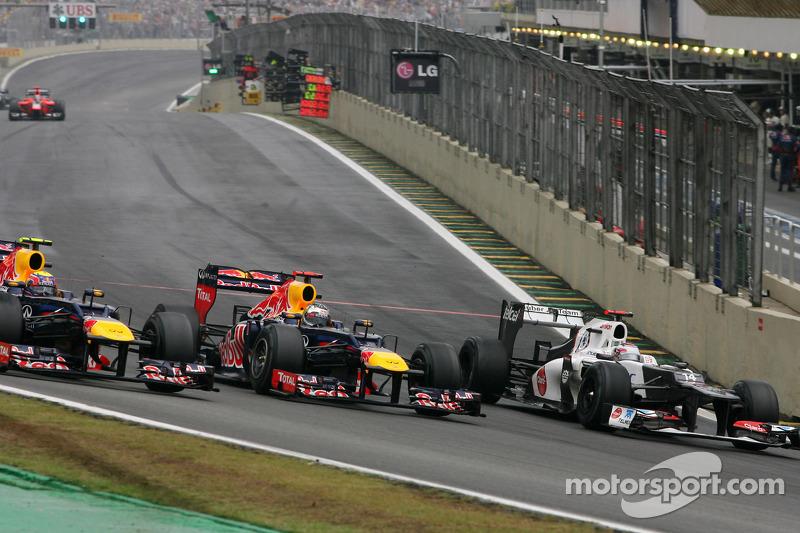 Марк Феббер (Red Bull), Себастьян Феттель (Red Bull) Камуї Кобаясі (Sauber)