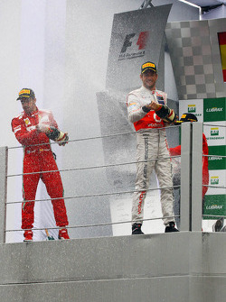 Race winner Jenson Button, McLaren celebrates on the podium with Fernando Alonso, Ferrari