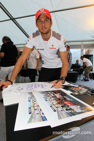 Jenson Button, McLaren Mercedes, signs memorabilia for Great Ormond Street Hospital charity