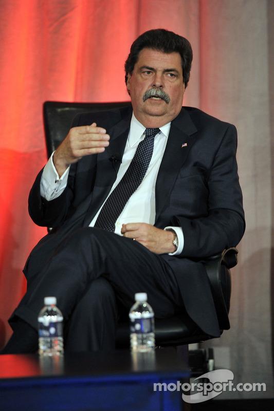 NASCAR President, Mike Helton speaks onstage at the NASCAR Motorsports Forum