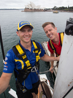 Lee Holdsworth and James Courtney taking part in the Ford vs Holden challenge on Sydney Harbour