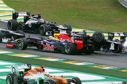 Sebastian Vettel, Red Bull Racing survives a crash with Bruno Senna, Williams at the start of the ra