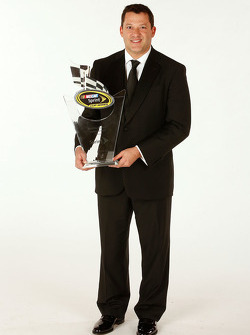 Tony Stewart with the ninth place trophy