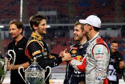 Second place Romain Grosjean and first place Michael Schumacher, Sebastian Vettel