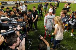 First place Sebastian Vettel and Michael Schumacher
